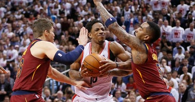 Cleveland Cavaliers guard Kyle Korver (26) and guard JR Smith (5) defend against Toronto Raptors guard DeMar DeRozan (10) during game one of the second round of the 2018 NBA Playoffs at Air Canada Centre.