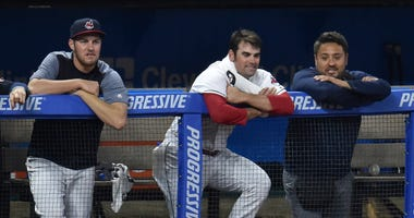 May 3, 2018; Cleveland, OH, USA; Cleveland Indians starting pitcher Adam Plutko, center, watches from the dugout in the eighth inning against the Toronto Blue Jays at Progressive Field.