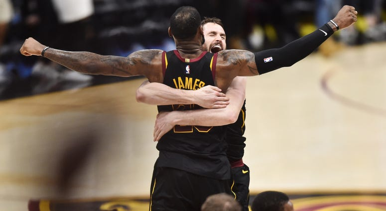 May 5, 2018; Cleveland, OH, USA; Cleveland Cavaliers forward LeBron James (23) and center Kevin Love (0) celebrate after James hit the final shot to win the game against the Toronto Raptors in game three of the second round of the 2018 NBA Playoffs at Qui