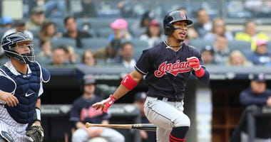 May 6, 2018; Bronx, NY, USA; Cleveland Indians shortstop Francisco Lindor (12) hits an RBI single in the eighth inning against the New York Yankees at Yankee Stadium.