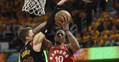 Raptors guard DeMar DeRozan (10) drives against Cleveland Cavaliers guard Kyle Korver (26) in the first quarter in game four of the second round of the 2018 NBA Playoffs at Quicken Loans Arena