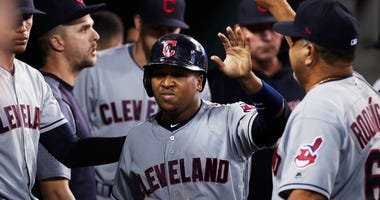 May 14, 2018; Detroit, MI, USA; Cleveland Indians third baseman Jose Ramirez (11) is congratulated by teammates after scoring in the eighth inning against the Detroit Tigers at Comerica Park.