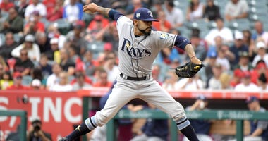 May 20, 2018; Anaheim, CA, USA; Tampa Bay Rays starting pitcher Sergio Romo (54) delivers a pitch in th first inning against the Los Angeles Angels at Angel Stadium of Anaheim.