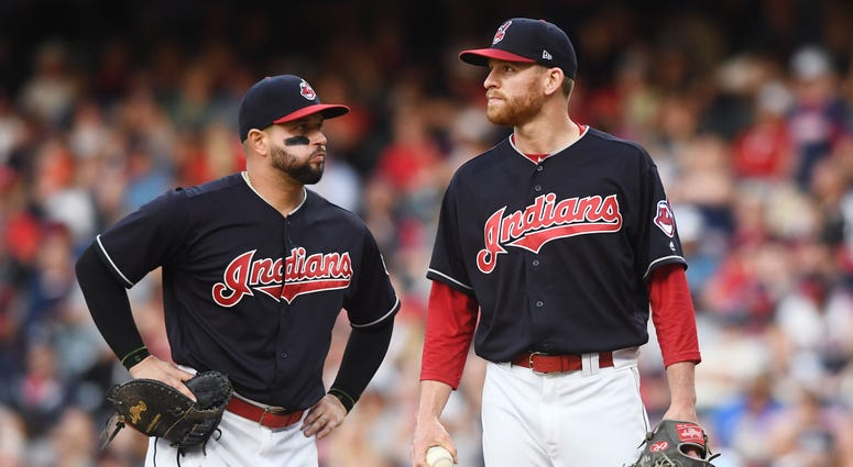 May 24, 2018; Cleveland, OH, USA; Cleveland Indians first baseman Yonder Alonso (17) and relief pitcher Neil Ramirez (58) react on the mound as Ramirez is relieved during the sixth inning against the Houston Astros at Progressive Field.