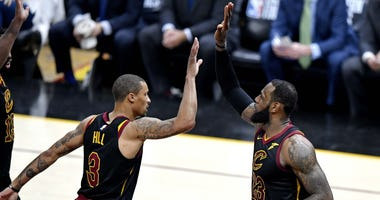 Cleveland Cavaliers forward LeBron James (23) celebrates with guard George Hill (3) during the third quarter against the Boston Celtics in game six of the Eastern conference finals of the 2018 NBA Playoffs at Quicken Loans Arena