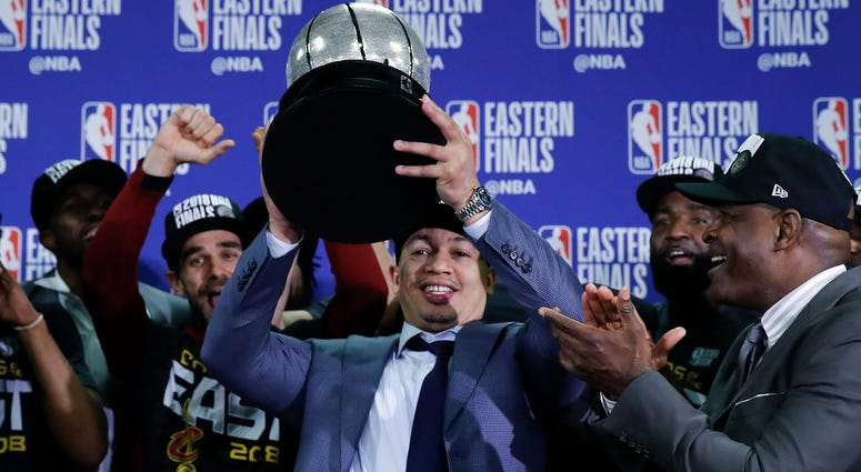May 27, 2018; Boston, MA, USA; Cleveland Cavaliers head coach Tyronn Lue holds up the Eastern Conference trophy after defeating the Boston Celtics in the 2018 NBA Playoffs at TD Garden. Mandatory Credit: David Butler II-USA TODAY Sports