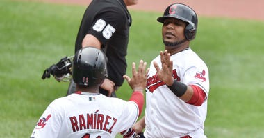 May 30, 2018; Cleveland, OH, USA; Cleveland Indians third baseman Jose Ramirez (11) and designated hitter Edwin Encarnacion (10) celebrate after scoring in the third inning against the Chicago White Sox at Progressive Field.