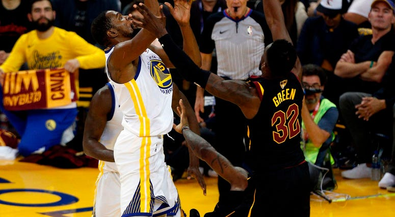 May 31, 2018; Oakland, CA, USA; Golden State Warriors forward Kevin Durant (35) collides with Cleveland Cavaliers forward LeBron James (23) on a scoring drive during the second half in game one of the 2018 NBA Finals at Oracle Arena.