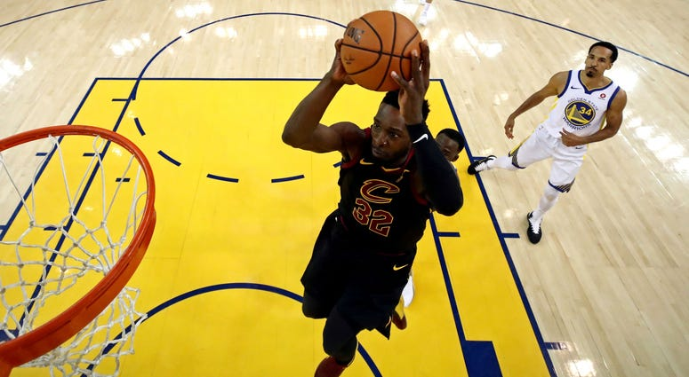 Cleveland Cavaliers forward Jeff Green (32) shoots the ball against Golden State Warriors forward Draymond Green (23) in game one of the 2018 NBA Finals at Oracle Arena.