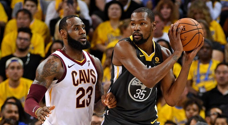 Golden State Warriors forward Kevin Durant (35) handles the ball against Cleveland Cavaliers forward LeBron James (23) during the second quarter in game two of the 2018 NBA Finals