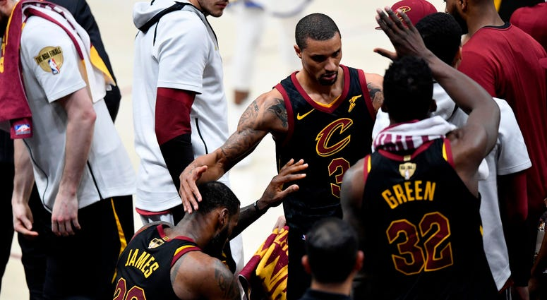 Jun 8, 2018; Cleveland, OH, USA; Cleveland Cavaliers forward LeBron James (23) reacts with guard George Hill (3) at the bench after leaving the game during the fourth quarter in game four of the 2018 NBA Finals Golden State Warriors at Quicken Loans Arena