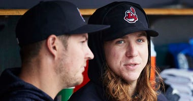 Jun 10, 2018; Detroit, MI, USA; Cleveland Indians starting pitcher Trevor Bauer (47) and starting pitcher Mike Clevinger (52) talk in the dugout during the sixth inning against the Detroit Tigers at Comerica Park. Mandatory Credit: Rick Osentoski-USA TODA