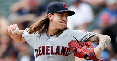 Jun 14, 2018; Chicago, IL, USA; Cleveland Indians starting pitcher Mike Clevinger (52) pitches against the Chicago White Sox during the first inning at Guaranteed Rate Field.