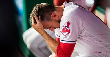 Jul 10, 2018; Cleveland, OH, USA; Cleveland Indians relief pitcher Dan Otero (61) holds his head in the dugout after giving up the go-ahead hit to the Cincinnati Reds during the ninth inning at Progressive Field.
