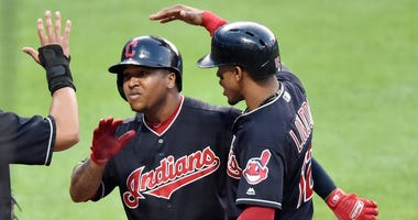 Jul 11, 2018; Cleveland, OH, USA; Cleveland Indians third baseman Jose Ramirez (11) celebrates with shortstop Francisco Lindor (right) after hitting a three-run home run against the Cincinnati Reds in the third inning at Progressive Field.