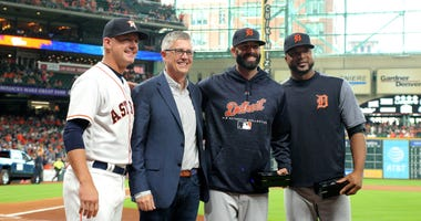(from L-to-R) Houston Astros manager AJ Hinch (14) and Houston Astros President of Baseball Operations Jeff Luhnow pose with Detroit Tigers starting pitchers Mike Fiers (50) and Francisco Liriano (38) prior to the game at Minute Maid Park.