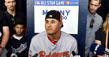 American League infielder Manny Machado of the Baltimore Orioles (13) talks with reporters during workouts in preparation for the 2018 MLB All Star Game at Nationals Ballpark.