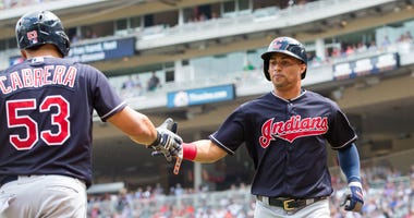 Cleveland Indians outfielder Leonys Martin (13) celebrates his run with outfielder Melky Cabrera (53) in the eighth inning against Minnesota Twins at Target Field.