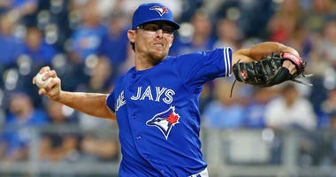 Aug 14, 2018; Kansas City, MO, USA; Toronto Blue Jays relief pitcher Tyler Clippard (36) pitches against the Kansas City Royals in the eighth inning at Kauffman Stadium. Mandatory Credit: Jay Biggerstaff-USA TODAY Sports