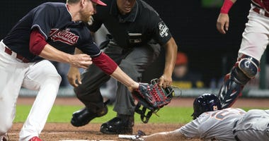 Detroit Tigers center fielder JaCoby Jones (21) scores on a wild pitch as Cleveland Indians relief pitcher Neil Ramirez (58) covers the plate during the eighth inning at Progressive Field.