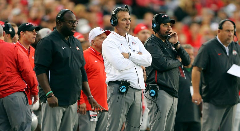 Ohio State Buckeyes head coach Urban Meyer (center) watches the game from the sidelines with assistant coach Ryan Day (right) and assistant coach Tony Alford (left) during the third quarter against the Ohio State Buckeyes at Ohio Stadium.