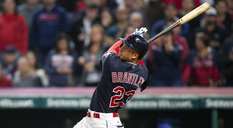 Sep 22, 2018; Cleveland, OH, USA; Cleveland Indians left fielder Michael Brantley (23) hits a single to score the game winning run against the Boston Red Sox during the eleventh inning at Progressive Field. The Indians won 5-4. Mandatory Credit: Scott R.