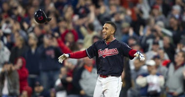 Cleveland Indians left fielder Michael Brantley (23) tosses his helmet as he celebrates his single to score the game winning run against the Boston Red Sox during the eleventh inning at Progressive Field. The Indians won 5-4.