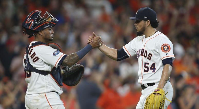 Houston Astros catcher Martin Maldonado and relief pitcher Roberto Osuna Game 1 ALDS