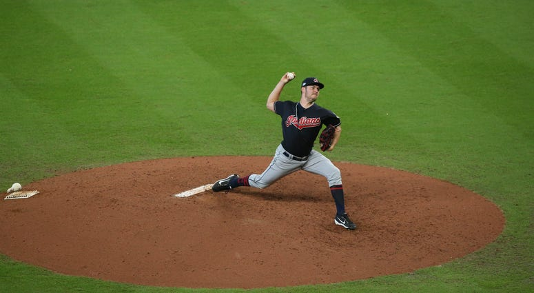 Oct 6, 2018; Houston, TX, USA; Cleveland Indians starting pitcher Trevor Bauer (47) delivers a pitch during the sixth inning against the Houston Astros during game two of the 2018 ALDS playoff baseball series at Minute Maid Park.