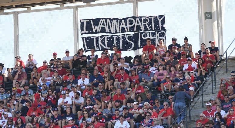 Oct 8, 2018; Cleveland, OH, USA; Fans display a sign in the game between the Cleveland Indians and the Houston Astros during game three of the 2018 ALDS playoff baseball series at Progressive Field.