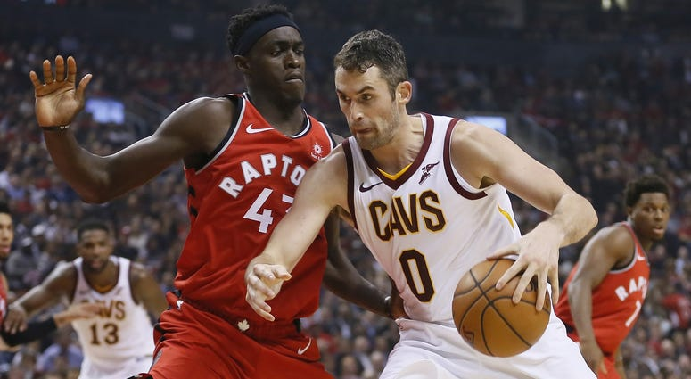 Oct 17, 2018; Toronto, Ontario, CAN; Cleveland Cavaliers forward Kevin Love (0) drives to the net against Toronto Raptors forward Pascal Siakam (43) during the first half at Scotiabank Arena. Mandatory Credit: John E. Sokolowski-USA TODAY Sports