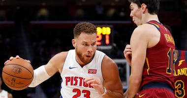 Oct 25, 2018; Detroit, MI, USA; Detroit Pistons forward Blake Griffin (23) dribbles the ball around Cleveland Cavaliers forward Cedi Osman (16) during the first quarter at Little Caesars Arena. Mandatory Credit: Raj Mehta-USA TODAY Sports
