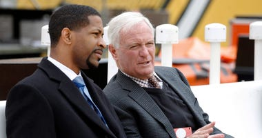 Cleveland Browns vice president Andrew Berry (L) talks with Browns owner Jimmy Haslam (R) on the bench before the Browns play the Pittsburgh Steelers at Heinz Field