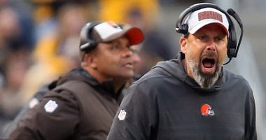 Cleveland Browns offensive coordinator Todd Haley (middle) reacts to line judge Gary Arthur (108) against the Pittsburgh Steelers during the third quarter at Heinz Field. The Steelers won 33-18.