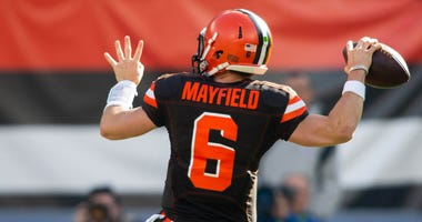 Cleveland Browns quarterback Baker Mayfield (6) completes a pass against the Kansas City Chiefs during the first quarter at FirstEnergy Stadium.