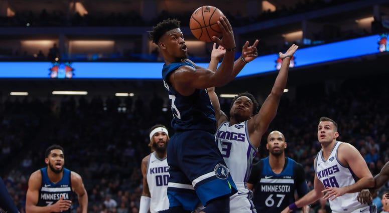 Minnesota Timberwolves guard Jimmy Butler (23) passes the ball against Sacramento Kings guard Yogi Ferrell (3) during the second quarter at Golden 1 Center.