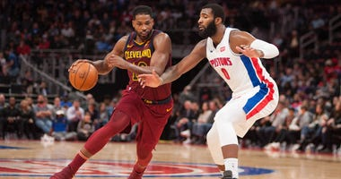 Cleveland Cavaliers center Tristan Thompson (13) drives to the basket as Detroit Pistons center Andre Drummond (0) defends during the third quarter at Little Caesars Arena