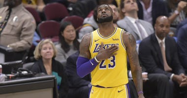 Los Angeles Lakers forward LeBron James (23) reacts in the third quarter against the Cleveland Cavaliers at Quicken Loans Arena.