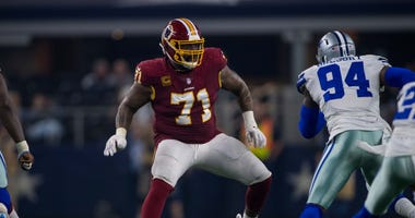 Nov 22, 2018; Arlington, TX, USA; Washington Redskins offensive tackle Trent Williams (71) and Dallas Cowboys defensive end Randy Gregory (94) in action during the game between the Dallas Cowboys and Washington Redskins at AT&T Stadium.