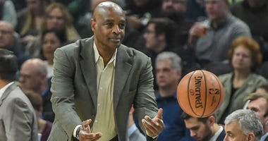 Dec 10, 2018; Milwaukee, WI, USA; Cleveland Cavaliers head coach Larry Drew tosses the ball back in play in the first quarter during the game against the Milwaukee Bucks at the Fiserv Forum. Mandatory Credit: Benny Sieu-USA TODAY Sports