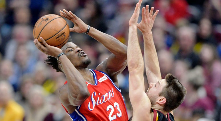Philadelphia 76ers guard Jimmy Butler (23) shoots against Cleveland Cavaliers guard Matthew Dellavedova (18) in the second quarter at Quicken Loans Arena.