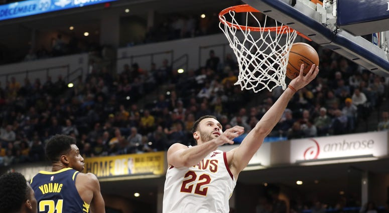 Dec 18, 2018; Indianapolis, IN, USA; Cleveland Cavaliers forward Larry Nance Jr. (22) shoots against Indiana Pacers forward Thaddeus Young (21) during the third quarter at Bankers Life Fieldhouse. Mandatory Credit: Brian Spurlock-USA TODAY Sports