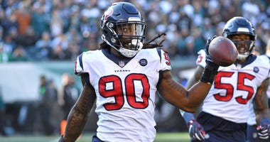Houston Texans outside linebacker Jadeveon Clowney (90) celebrates after recovering fumble against the Philadelphia Eagles during the second quarter at Lincoln Financial Field.