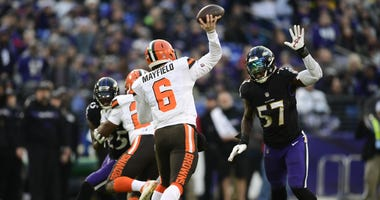 Dec 30, 2018; Baltimore, MD, USA; Cleveland Browns quarterback Baker Mayfield (6) throws as Baltimore Ravens inside linebacker C.J. Mosley (57) rushes during the first quarter at M&T Bank Stadium. Mandatory Credit: Tommy Gilligan-USA TODAY Sports