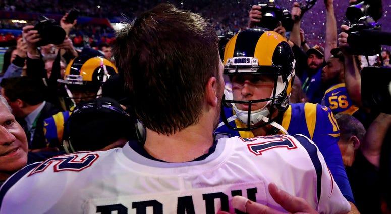 Feb 3, 2019; Atlanta, GA, USA; New England Patriots quarterback Tom Brady (12) greets Los Angeles Rams quarterback Jared Goff (16) after Super Bowl LIII at Mercedes-Benz Stadium. Mandatory Credit: Matthew Emmons-USA TODAY Sports