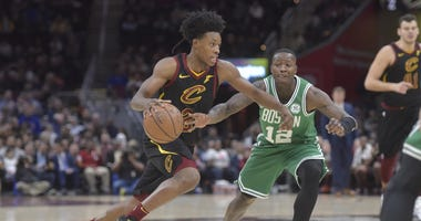 Feb 5, 2019; Cleveland, OH, USA; Cleveland Cavaliers guard Collin Sexton (2) dribbles against Boston Celtics guard Terry Rozier (12) in the second quarter at Quicken Loans Arena. Mandatory Credit: David Richard-USA TODAY Sports