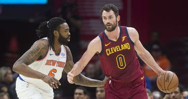 Feb 11, 2019; Cleveland, OH, USA; New York Knicks center DeAndre Jordan (6) guards Cleveland Cavaliers forward Kevin Love (0) during the first half at Quicken Loans Arena. Mandatory Credit: Ken Blaze-USA TODAY Sports