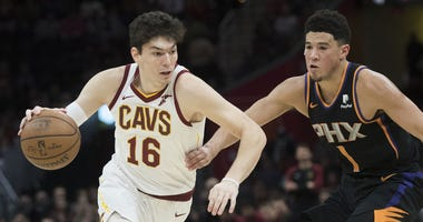 Feb 21, 2019; Cleveland, OH, USA; Cleveland Cavaliers forward Cedi Osman (16) drives to the basket against Phoenix Suns guard Devin Booker (1) during the second half at Quicken Loans Arena. Mandatory Credit: Ken Blaze-USA TODAY Sports
