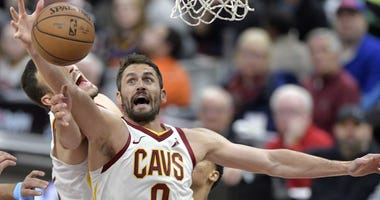 Feb 23, 2019; Cleveland, OH, USA; Cleveland Cavaliers forward Kevin Love (0) rebounds in the first quarter against the Memphis Grizzlies at Quicken Loans Arena. Mandatory Credit: David Richard-USA TODAY Sports