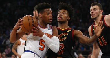 Feb 28, 2019; New York, NY, USA; Cleveland Cavaliers guard Collin Sexton (2) defends against New York Knicks guard Dennis Smith Jr. (5) during the first half at Madison Square Garden. Mandatory Credit: Noah K. Murray-USA TODAY Sports